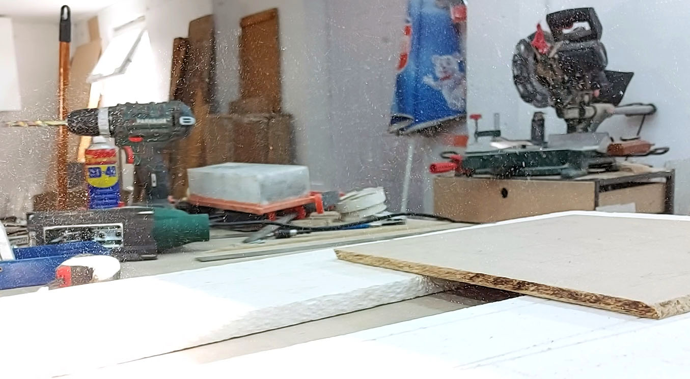Airborne dust in my workshop from cutting particleboard